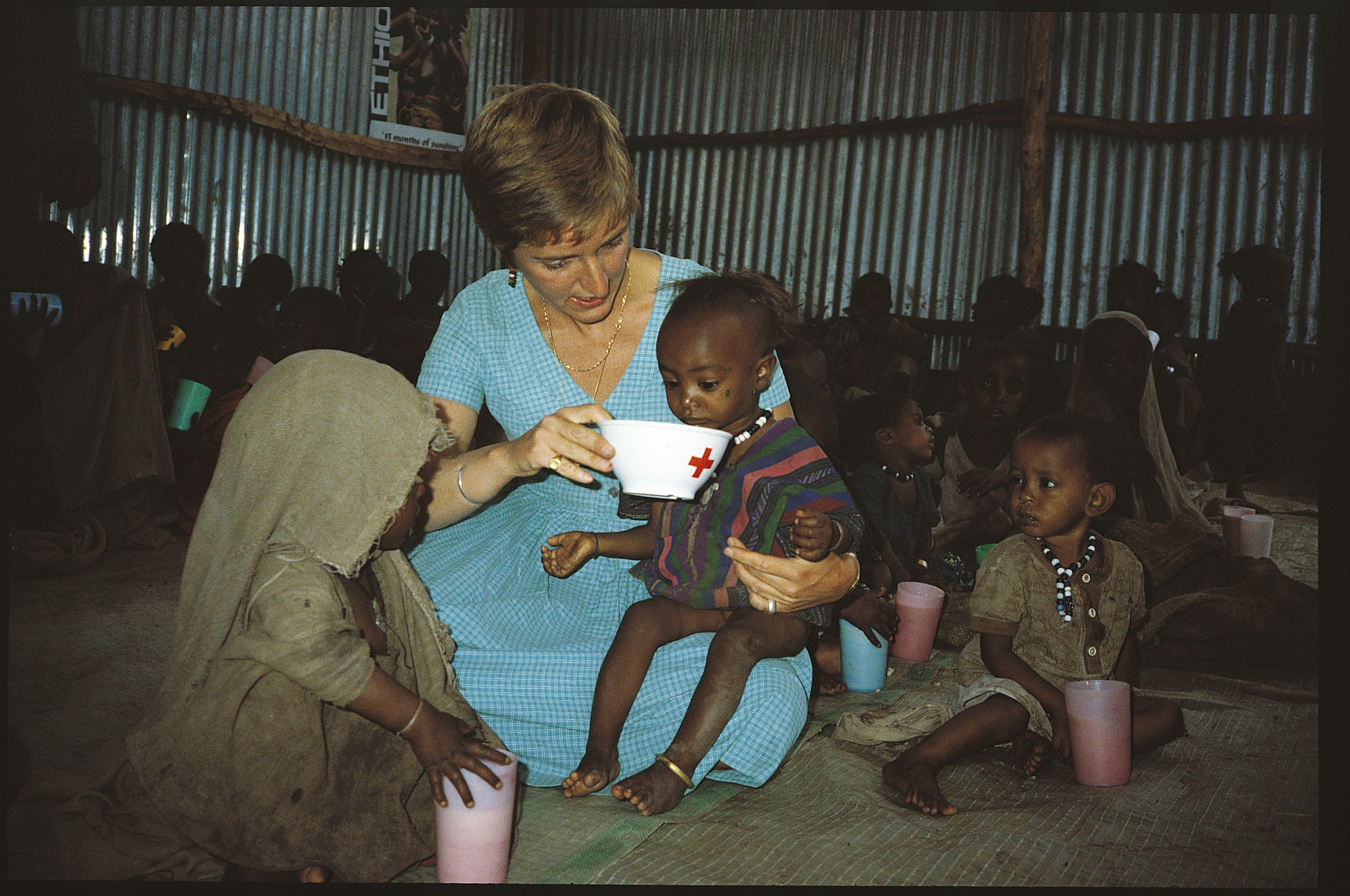 Caption: Claire Bertschinger feeding Ethiopian child. Credit: Claire Bertschinger