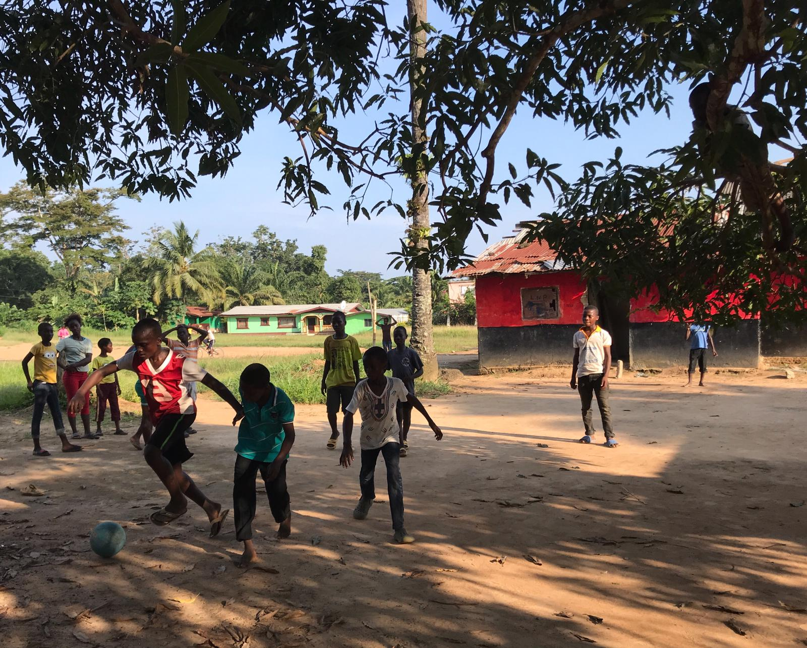 Local realities: children in Ganta, Nimba County, play football during a sunny afternoon