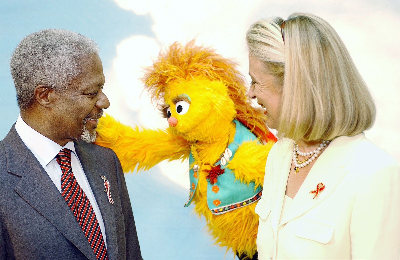 Former UN Secretary-General Kofi Annan (left) and his wife, Mrs. Nane Annan (right) pose with Kami, a HIV positive muppet on the South African version of Sesame Street whose name means acceptance in the Tswana language. Credit: UN Photo/Evan Schneider