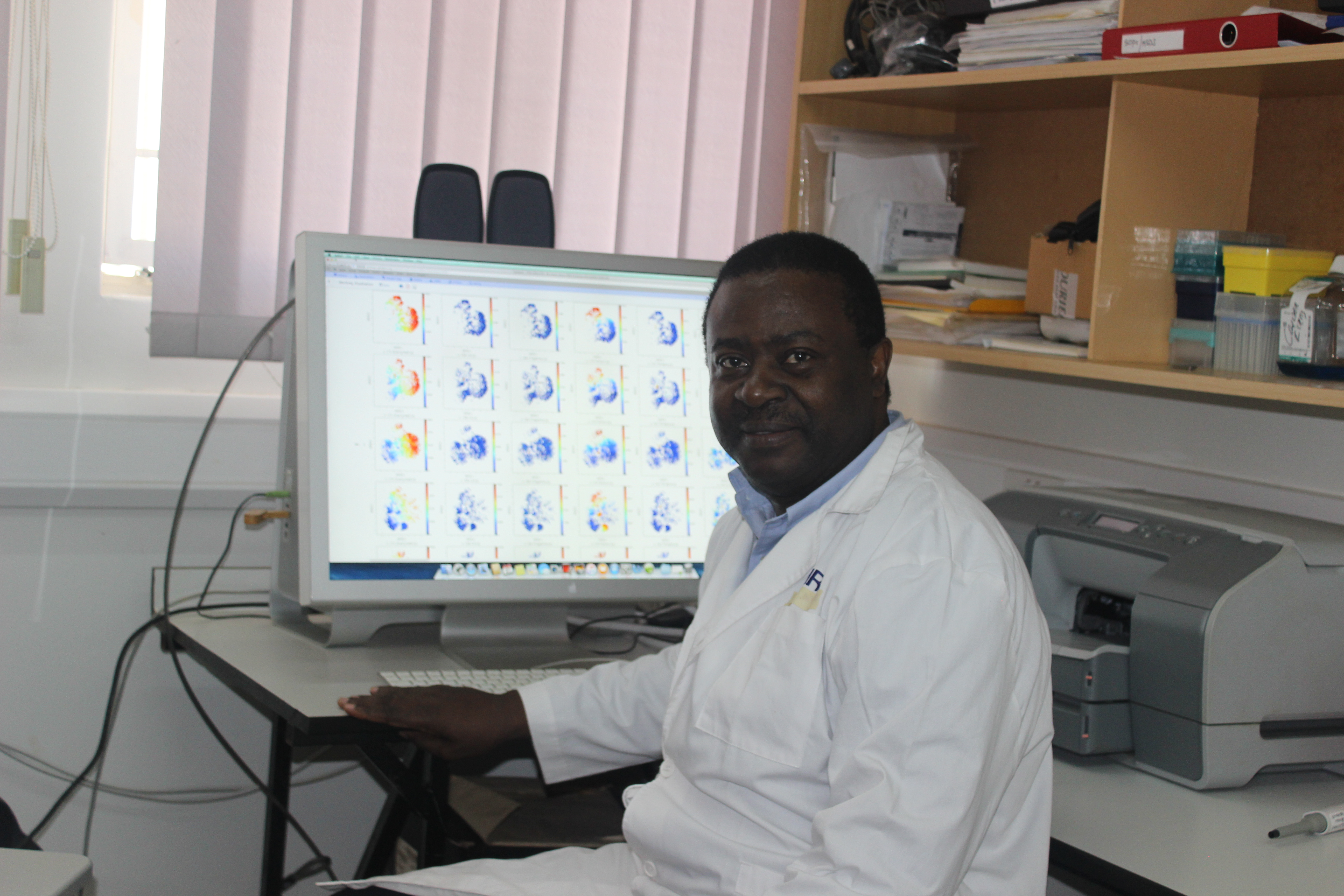 Prof Pontiano Kaleebu Director of MRC Uganda Uganda Virus Research Institute at his desk in Entebbe