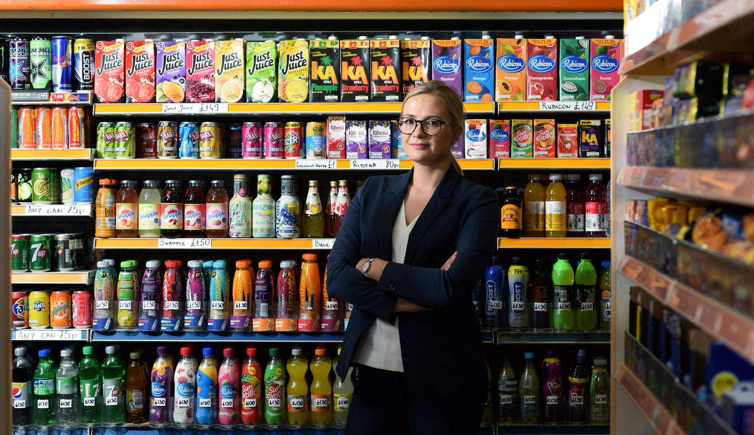 Caption: Laura Cornelsen in front of sugar snack shelves. Credit: Christian Sinibaldi