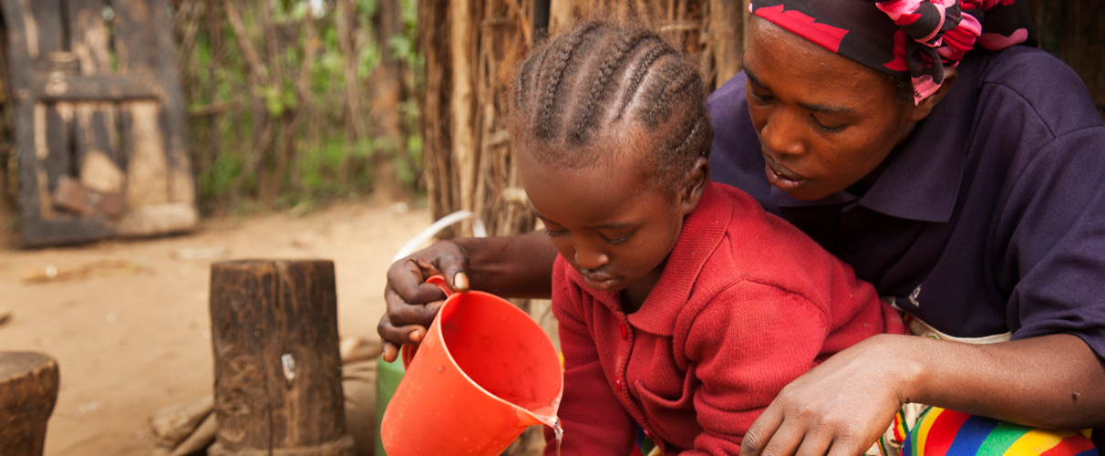 Timara with her daughter Wutinesh, washing with clean water in Konso, Ethiopia.