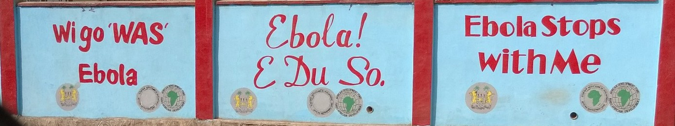 Wall with Ebola messages in Freetown, Sierra Leone, 2014. Credit: Jimmy Whitworth