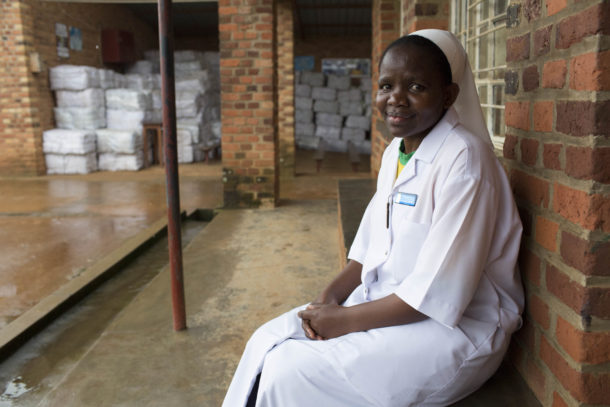 Sister Sophie Akimpaye outside her clinic in Rwanda. Credit: Tom Maguire/RESULTS UK