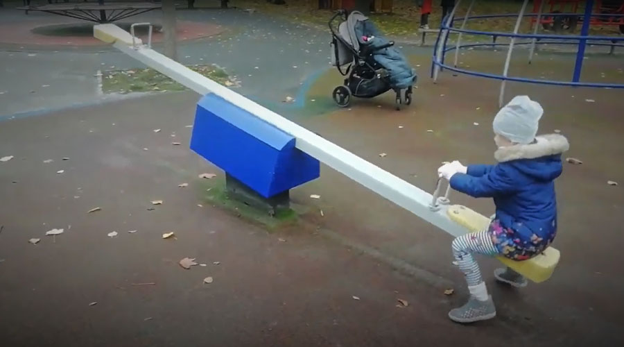 Child playing on seesaw