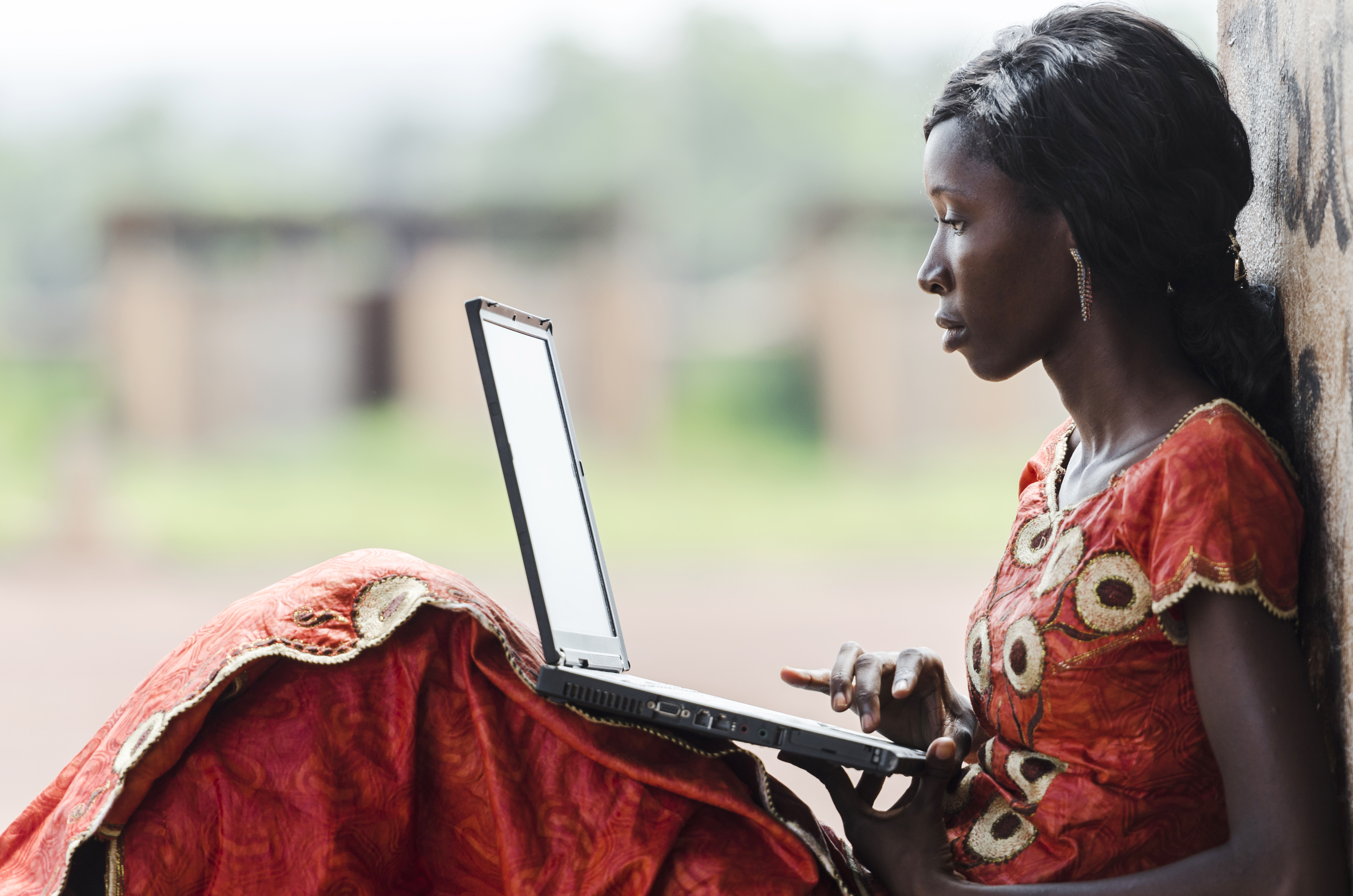 African woman with laptop