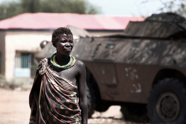 image of a woman standing in front of a military tank in south sudan