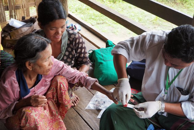 image of woman getting tested for malaria in southeast asia