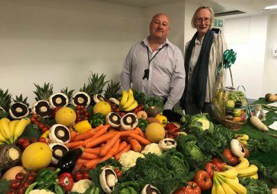 David Cole (Head of Catering at LSHTM) and Anne Mills (Deputy Director at LSHTM) at the fruit and vegetable stand for the Planetary Pick launch