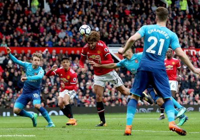 Marouane Fellaini heading a football during a match. Credit: Press Association