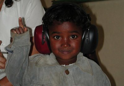 A participant in a population-based hearing survey in a low-income country has her hearing tested
