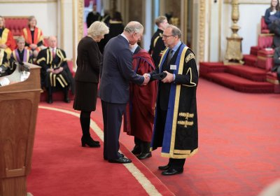 Caption: Peter Piot accepting Queen's Anniversary Prize. Credit: BCA Film/LSHTM