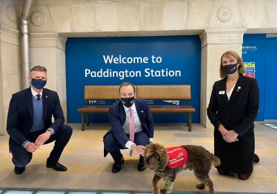 Professor James Logan, Matt Hancock and Dr Claire Guest at Paddington Station with one of the trial dogs, Asher