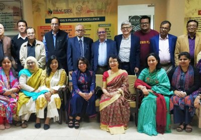 Group of alumni based in Dhaka, Bangladesh posing for a picture at their meeting