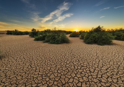 Caption: Arid landscape under a sunset. Credit: Pixabay