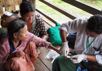 Woman getting tested for malaria in southeast asia