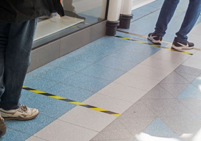 Markers on supermarket floor for customers to keep a safe distance
