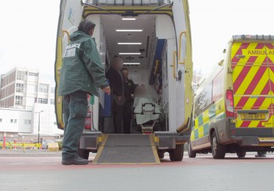 Paramedics preparing to bring a patient out the back of an ambulance at Queen Elizabeth Hospital, Birmingham. Credit: The Clinical Trials Unit, LSHTM.