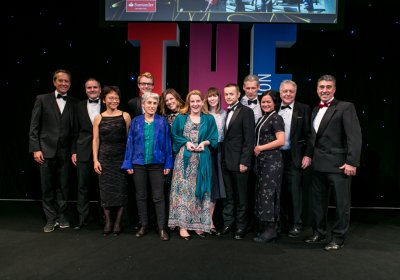 School staff collect the award