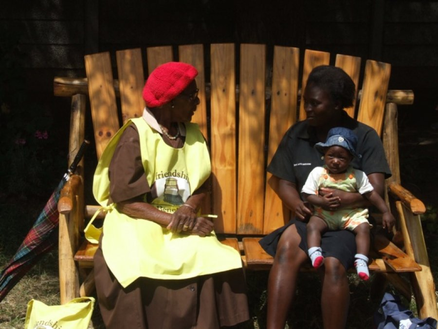 Caption: In Harare, a lay health worker provides problem solving therapy to a young mother. Credit: Friendship Bench