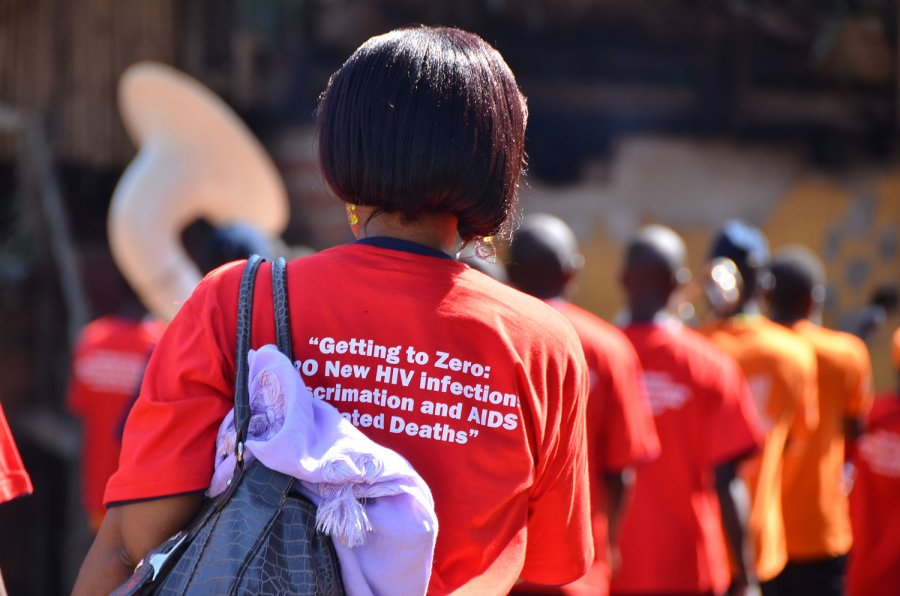 "A concerned parent in Kampala, Uganda, attends a ""Getting to ZERO"" awareness campaign aimed at getting zero new HIV infections."