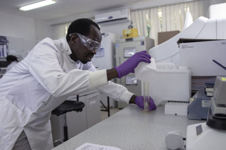 Caption: A researcher prepares a buffer solution for a high-throughput machine in a laboratory at the MRC/UVRI & LSHTM Uganda Research Unit, Entebbe, Uganda.