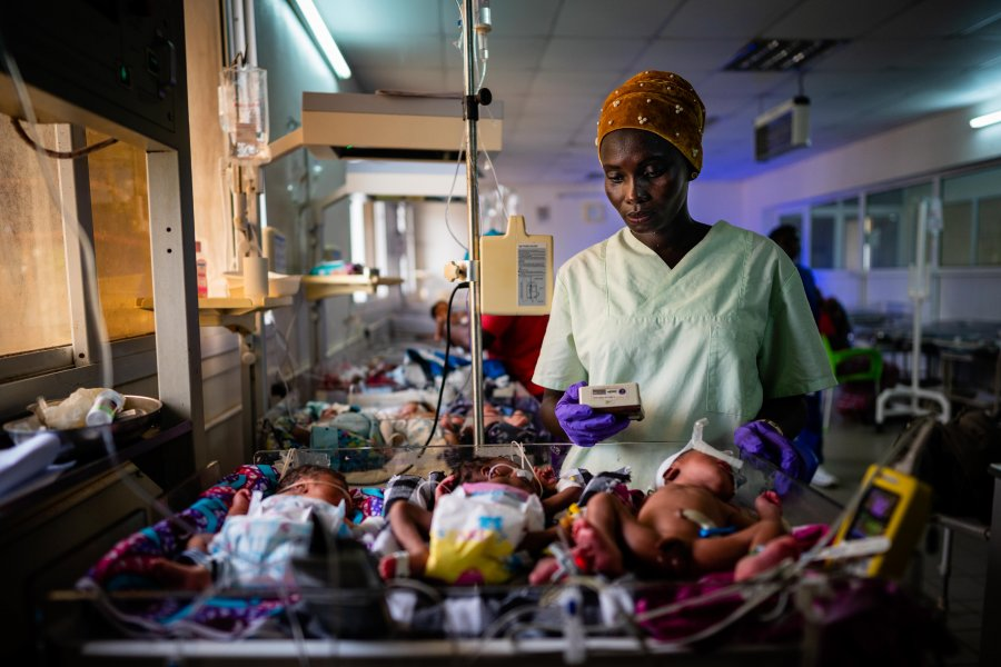 A research nurse screens a preterm baby for eligibility to the eKMC clinical trial, at Edward Francis Small Teaching Hospital, Banjul