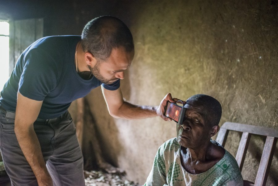 aption: Andrew Bastawrous uses the peek device to examine a Kenyan woman suffering from blindness. Credit: Rolex/Joan Bardeletti