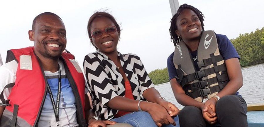 Students on a boat in The Gambia