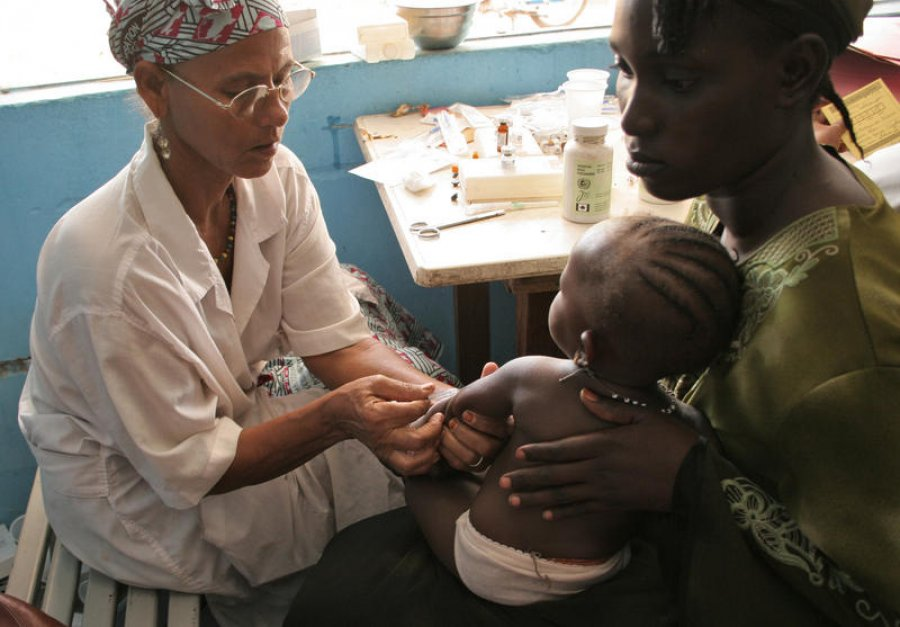 An infant receives treatment for malaria at a clinic in Mali
