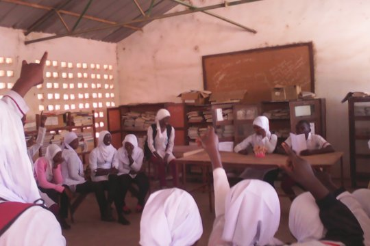 Peer health education session in school discussing menstruation issues