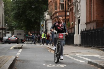 Lady cycling in London